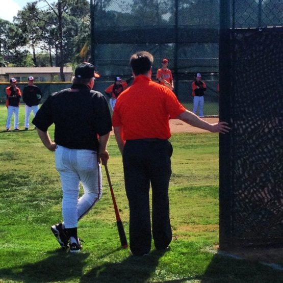 Manager Buck Showalter and EVP Dan Duquette watch the pitchers