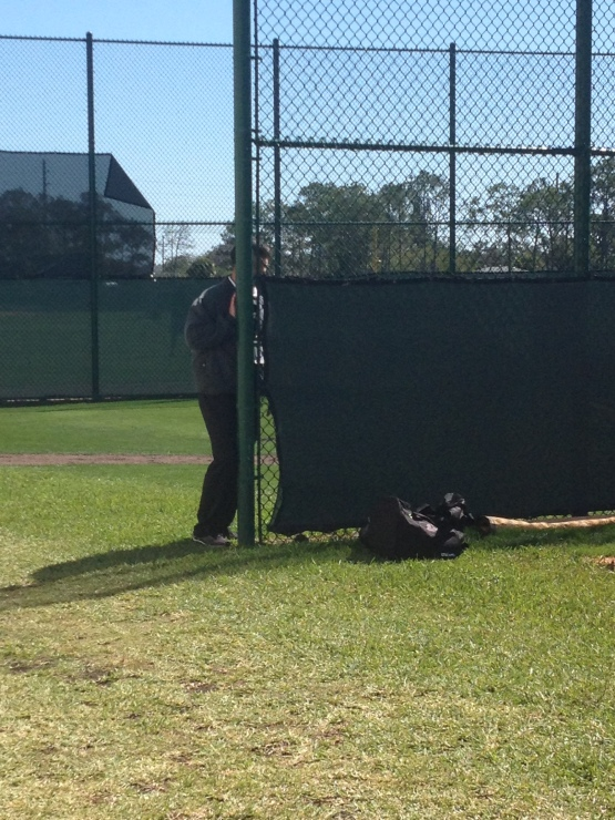 Executive vice president of baseball operations Dan Duquette watching some pitchers.
