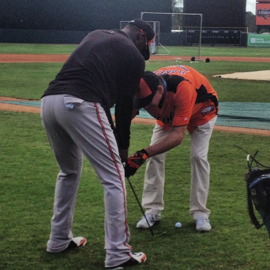 Adam Jones getting help on his golf swing from Hank Haney.