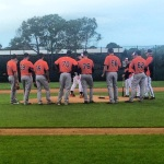 Group of pitchers watching Buck on the mound