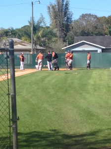 A group of catchers working out on the Earl Field